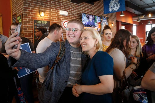 U.S. Senator and democratic presidential candidate hopeful Kirsten Gillibrand (D-NY) pauses for a selfie with a supporter after visiting Papa Keno's in Des Moines' Drake neighborhood on Tuesday, April 17, 2019.