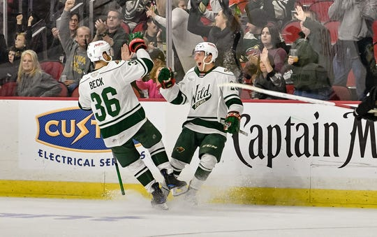 Colton Beck(36) and Gerry Mayhew (20) have had many more reasons to celebrate on the ice for the Iowa Wild this season. The AHL affiliate of the Minnesota Wild has reached the Calder Cup playoffs for the first time since relocating to Des Moines in 2013. The postseason opener is Sunday against Milwaukee in Game 1 of a best-of-5 series.