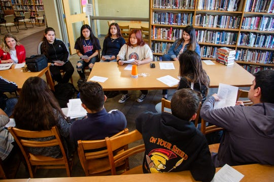 Beauna Thammathai, 16, center, leads a 4-H meeting at Storm Lake High School Monday, April 8, 2019.