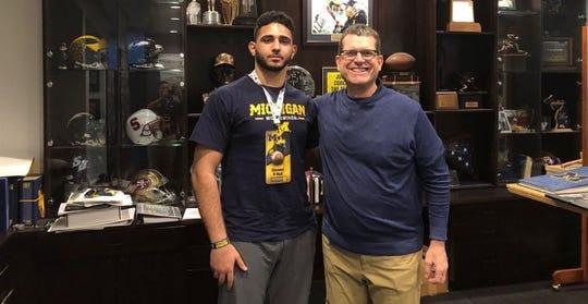 Giovanni El-Hadi with Michigan coach Jim Harbaugh.