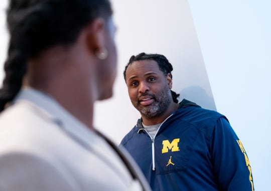 University of Michigan linebacker Devin Bush Jr. (left) looks back to his father Devin Bush Sr. while trying on suit options for the NFL draft at the University of Michigan Museum of Art in Ann Arbor on Friday, April 5, 2019.