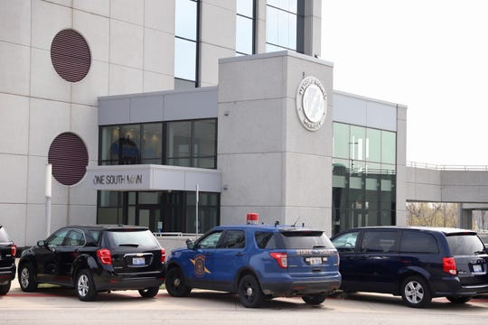 Investigators from the Michigan State Police removed records from Macomb County Prosecutor Eric Smith's office on Wednesday, April 17, 2019.