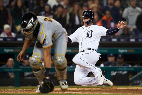 Detroit Tigers' Dustin Peterson slides safely at home plate ahead of the throw to Pittsburgh Pirates catcher Francisco Cervelli in the ninth inning at Comerica Park, Tuesday, April 16, 2019.