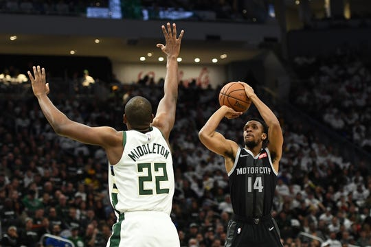 Detroit Pistons guard Ish Smith shoots over Khris Middleton of the Milwaukee Bucks during Game 1 of the first round of the NBA playoffs against the Milwaukee Bucks at Fiserv Forum on April 14, 2019 in Milwaukee.