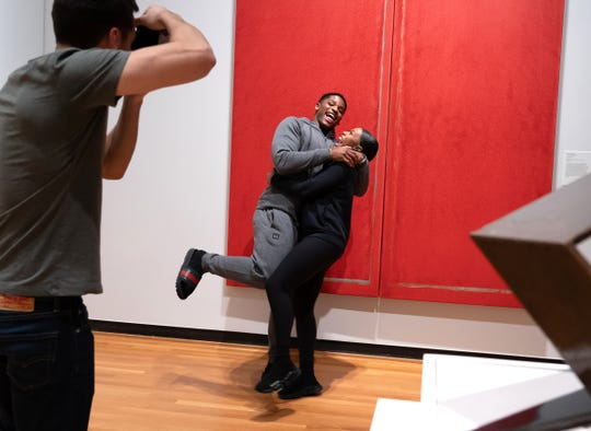 University of Michigan linebacker Devin Bush Jr. is held by his girlfriend Carissa Martin of Detroit while getting photographed after making his selection for a suit to wear for the NFL draft at the University of Michigan Museum of Art in Ann Arbor on Friday, April 5, 2019.
