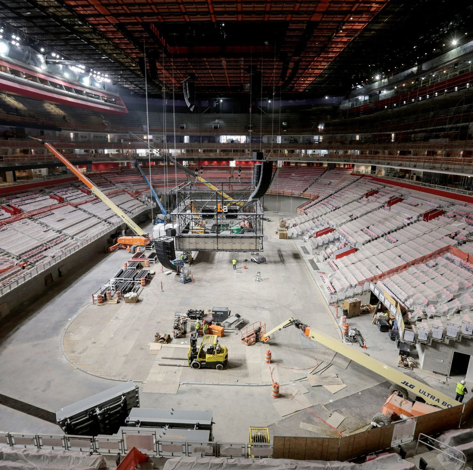 A worker's death at a Detroit arena was called a suicide. Some safety experts disagree