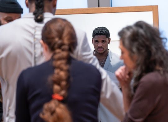University of Michigan linebacker Devin Bush Jr. looks in the mirror while being fitted for a suit selection to wear for the NFL draft at the University of Michigan Museum of Art in Ann Arbor on Friday, April 5, 2019.