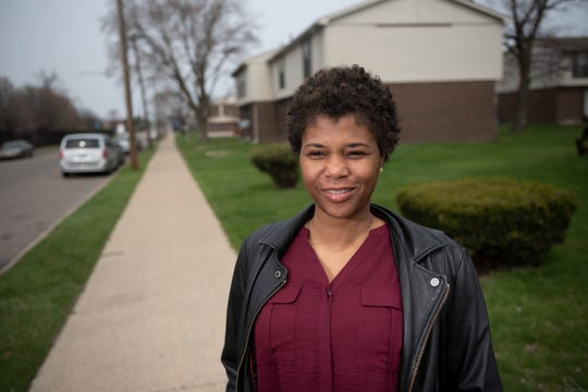 Tricia Talley, president of the North Corktown Neighborhood Association, stands outside the Fountain Court Cooperative Apartments in Detroit.
