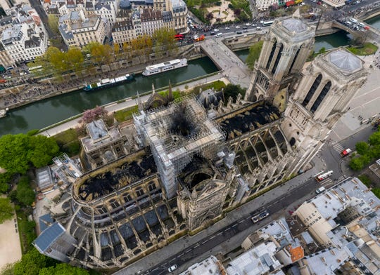 An image made available by Gigarama.ru on Wednesday April 17, 2019 shows an aerial shot of the fire damage to Notre Dame cathedral in Paris.