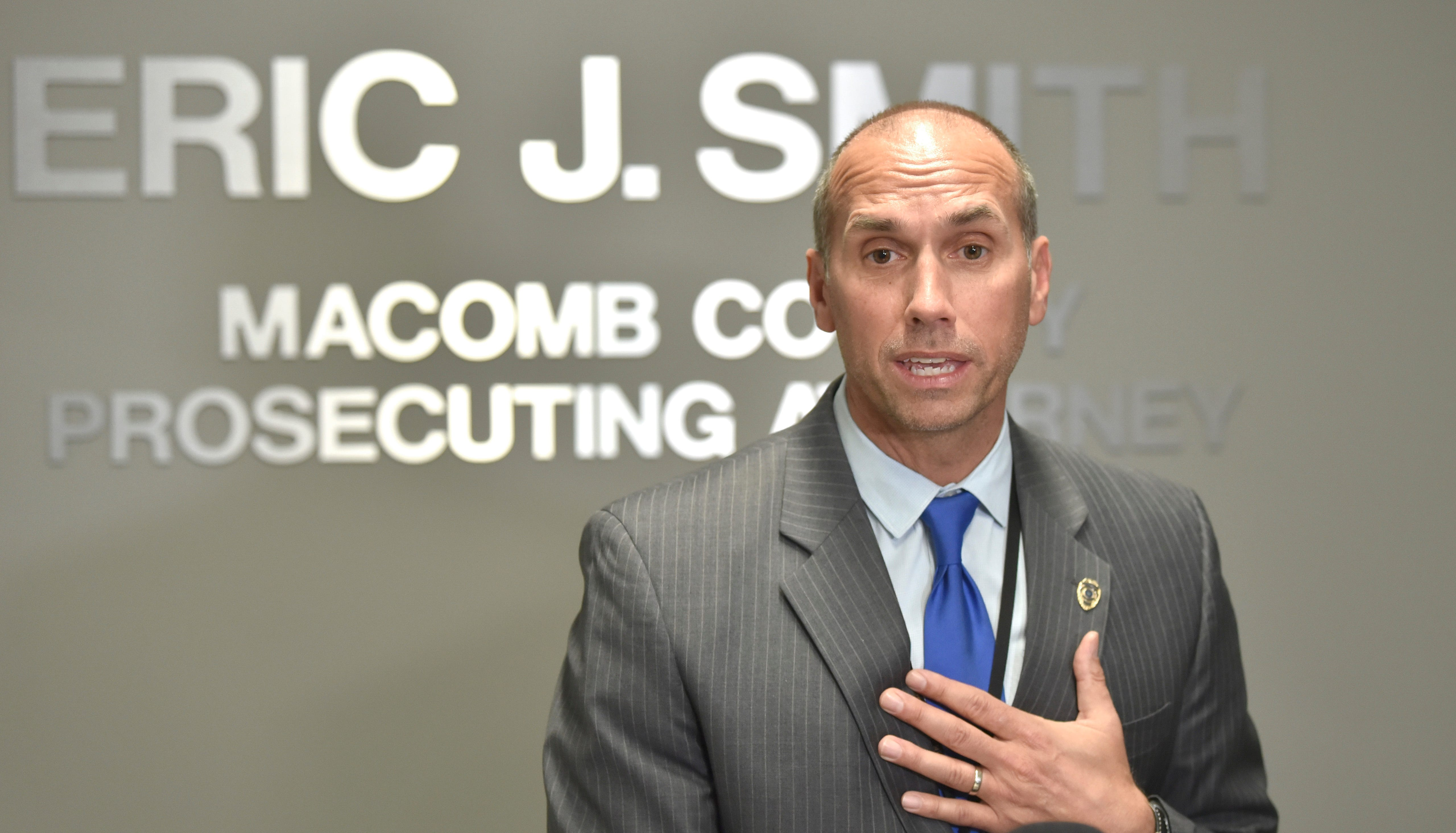 Smith promises to cooperate after state police search offices
