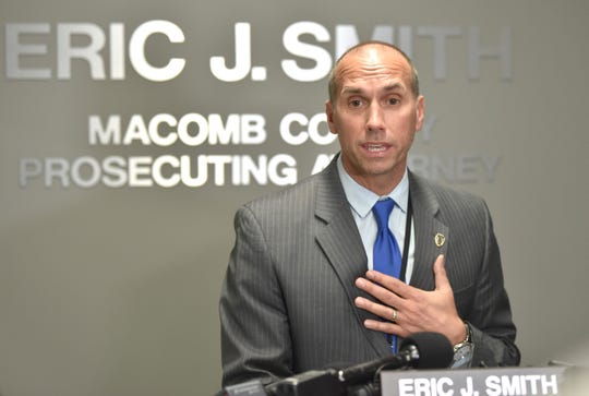 Macomb County Prosecutor Eric Smith says Wednesday at a press conference he is cooperating with investigators looking into his use of forfeiture funds.