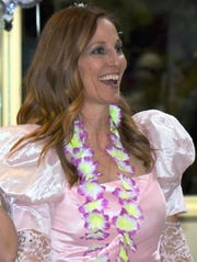 Wearing her own puffy pink senior prom dress from 1988, Mom Prom Founder Betsy Crapps is all smiles as she greets guests on the dance floor. Crapps conceived the event back in 2006 and its popularity has blossomed with over 120 proms springing up nationwide.