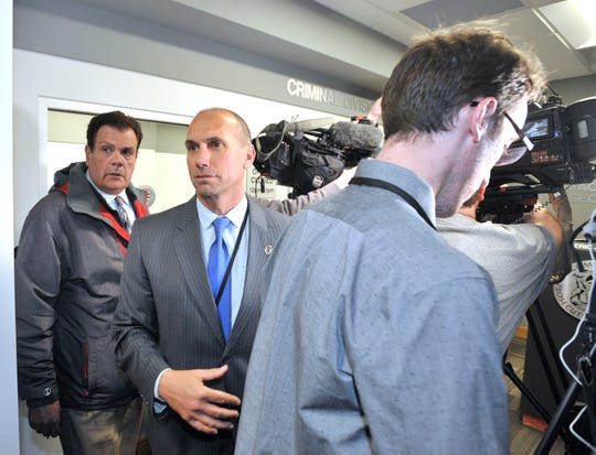 Macomb County Prosecutor Eric Smith makes his way through the press corps after his press conference.
