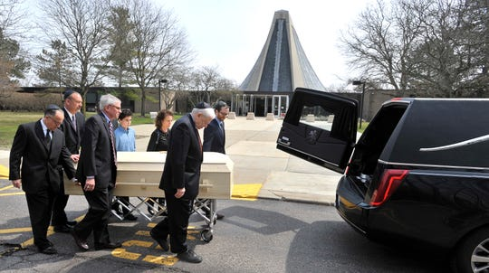 Pallbearers carry the casket of Detroit News Editor and Publisher Jon Wolman to a waiting hearse outside Temple Beth El in Bloomfield Hills, Wednesday, April 17, 2019. More than 180 family members and friends attended the memorial service at Temple Beth El. Wolman died Monday of complications from pancreatic cancer. He was 68.