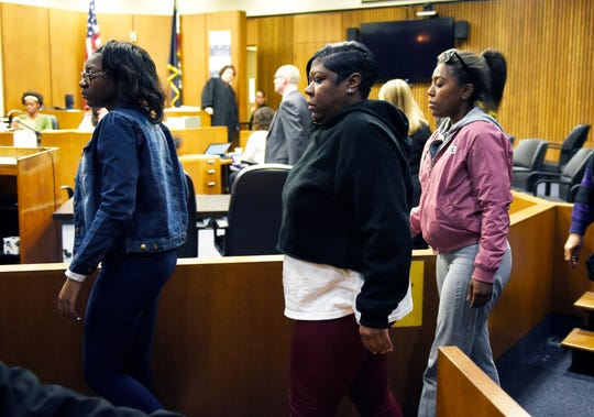 Monique Grimes (center) of Detroit, mother of Damon Grimes, leaves the courtroom with family members after the involuntary manslaughter guilty verdict against former MSP trooper Mark Bessner.