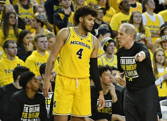 Isaiah Livers with former coach John Beilein.