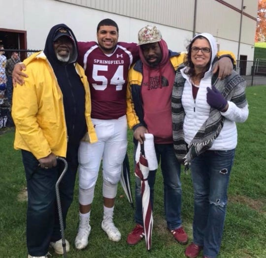 Ira Heyward Sr., left, with his grandson, Springfield College football player Grayson Heyward, son Leander and daughter-in-law Elizabeth Heyward.