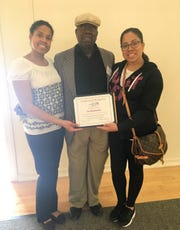 Ira Heyward Sr. with his daughters Christa Heyward, left, and Chelsea Heyward.