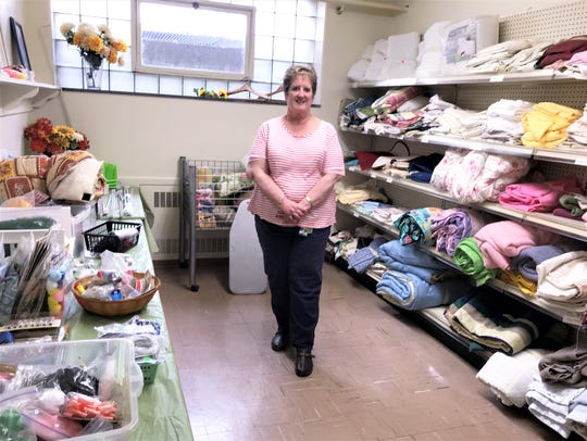 Trinity Episcopal Church member Sue Draht shows off one of seven rooms of donated merchandise that make up the church thrift shop.