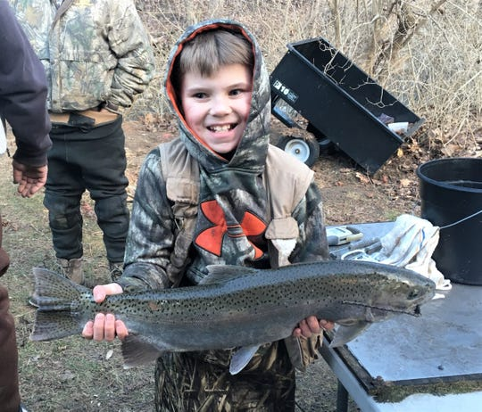 Keagen Thrall, 10, of Pine Valley, landed this dandy rainbow trout April 1 on Catharine Creek.