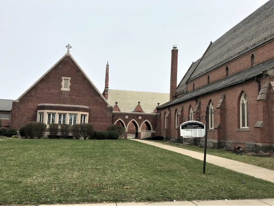 The leadership of Elmira's Trinity Episcopal Church plans to turn the church's parish hall, on the left, into a multi-faceted community center.