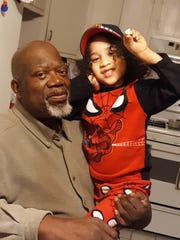 Ira Heyward with one of his grandchildren, Milo Heyward.