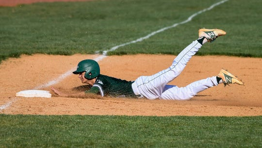 North's Alex Archuleta (11) slides into third base in the third inning as the North High Huskies play the Memorial Tigers at Memorial's N.J. Stone Field Tuesday, April 16, 2019.