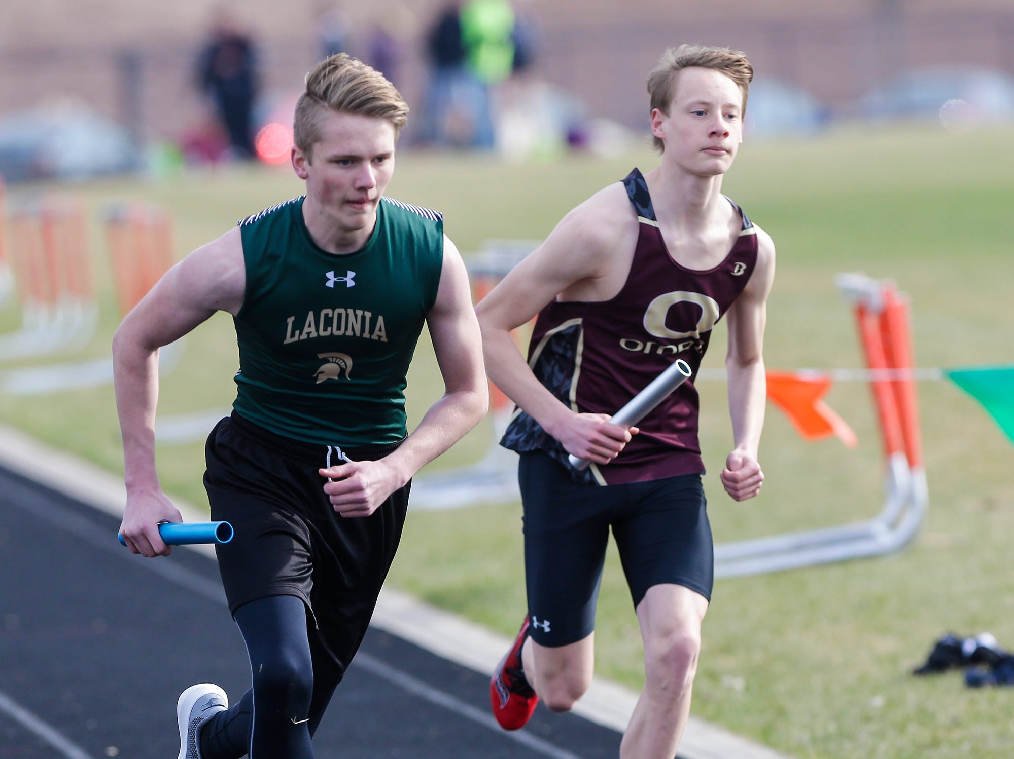 Laconia High School's Derek Stahmann and Omro's Hunter Crowley take part in the boys 4x800 meter relay Tuesday, April 16, 2019 at North Fond du Lac High School in North Fond du Lac, Wis. Doug Raflik/USA TODAY NETWORK-Wisconsin
