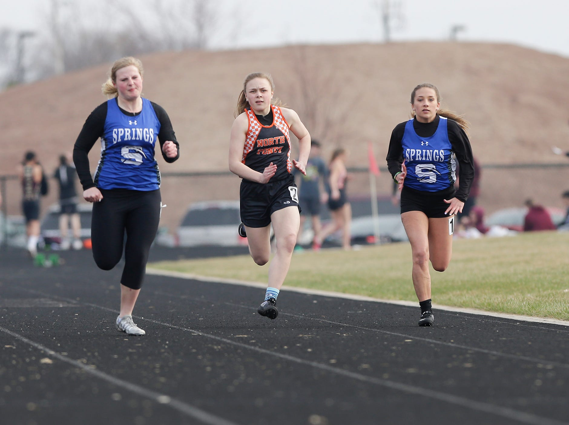 North Fond du Lac High School's Ailah Thoreson and St. Mary's Springs Academy's Peyton Hyland and Sarah Beisber take part in the girls 100 meter dash Tuesday, April 16, 2019 at North Fond du Lac High School in North Fond du Lac, Wis. Doug Raflik/USA TODAY NETWORK-Wisconsin