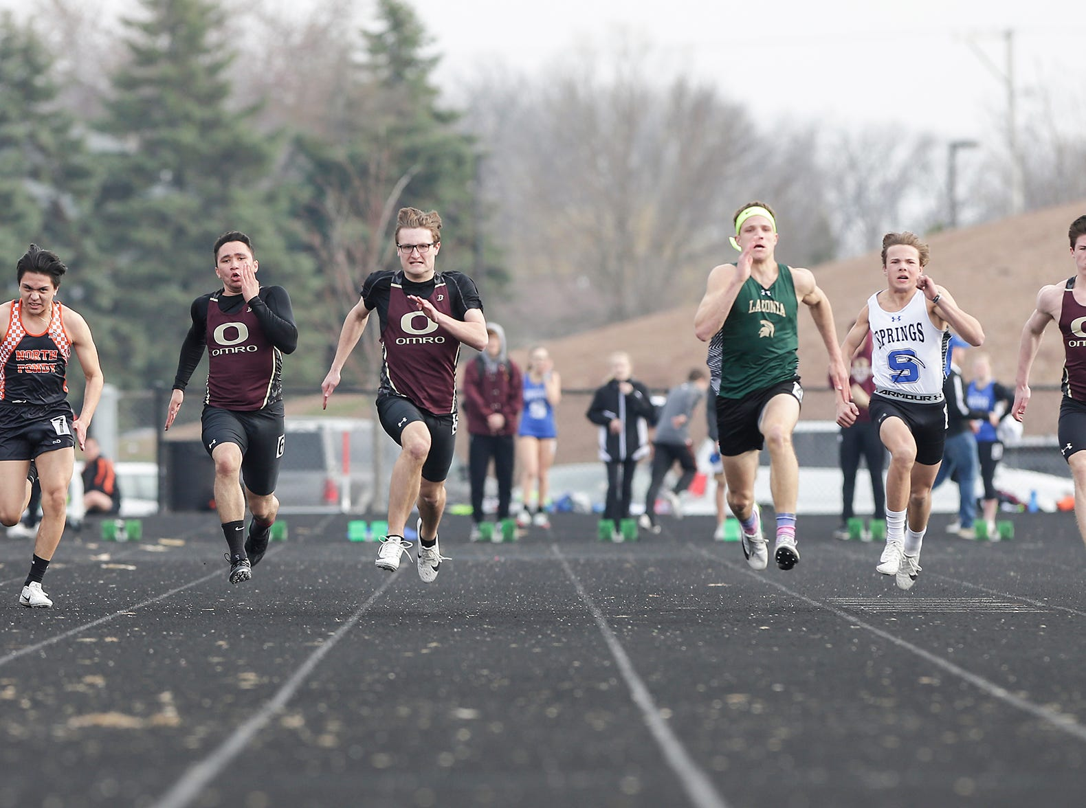 North Fond du Lac High School's Erick Gonzalez, Omro's Elijah Williams and Sam Joachim, Laconia's Jacob Davies, St. Mary's Springs Isaac Hyland and Omro's Logan Reiter take part in the boys 100 meter dash Tuesday, April 16, 2019 at North Fond du Lac High School in North Fond du Lac, Wis. Doug Raflik/USA TODAY NETWORK-Wisconsin