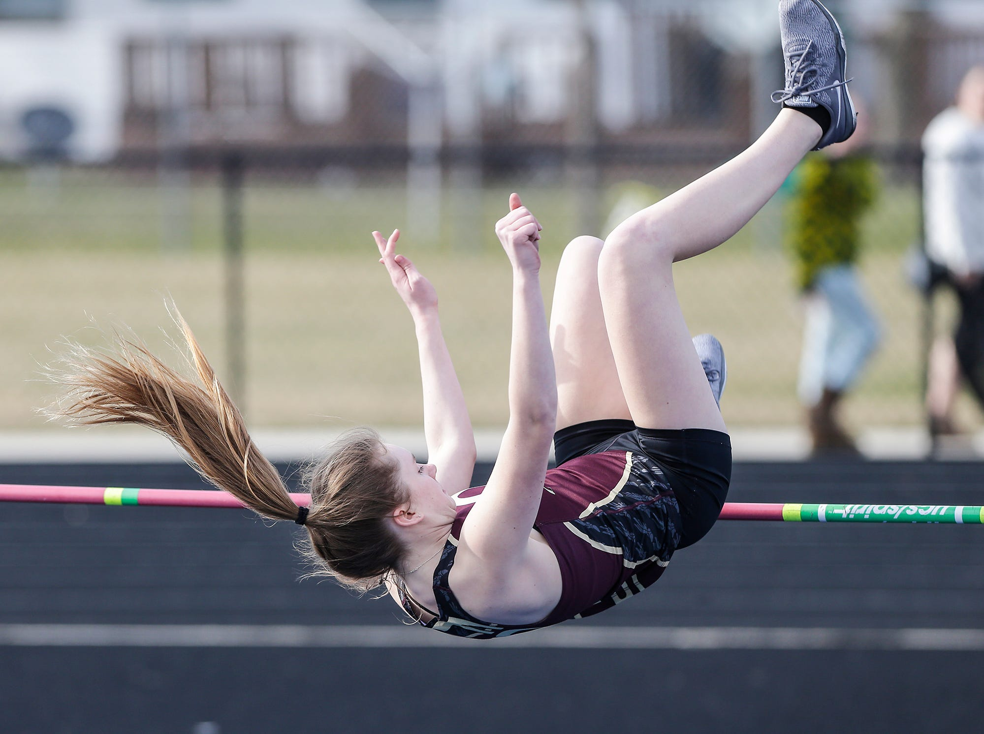 Omro High School's Lauren Koonce takes part in the high jump Tuesday, April 16, 2019 at North Fond du Lac High School in North Fond du Lac, Wis. Doug Raflik/USA TODAY NETWORK-Wisconsin