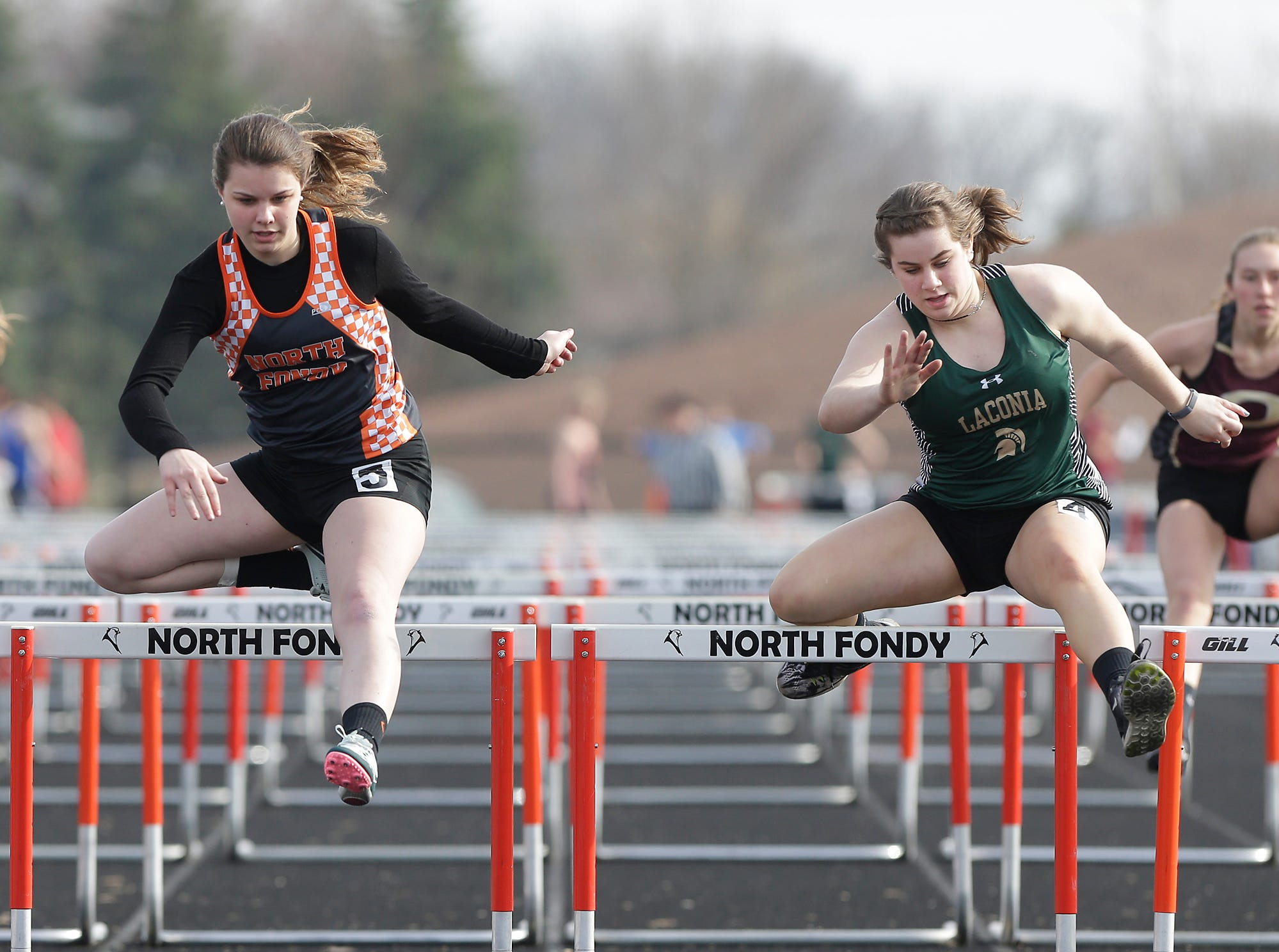 North Fond du Lac High School's Josey Wallender and Laconia's Cassie Coffeen take part in the girls 100 meter hurdels Tuesday, April 16, 2019 at North Fond du Lac High School in North Fond du Lac, Wis. Doug Raflik/USA TODAY NETWORK-Wisconsin