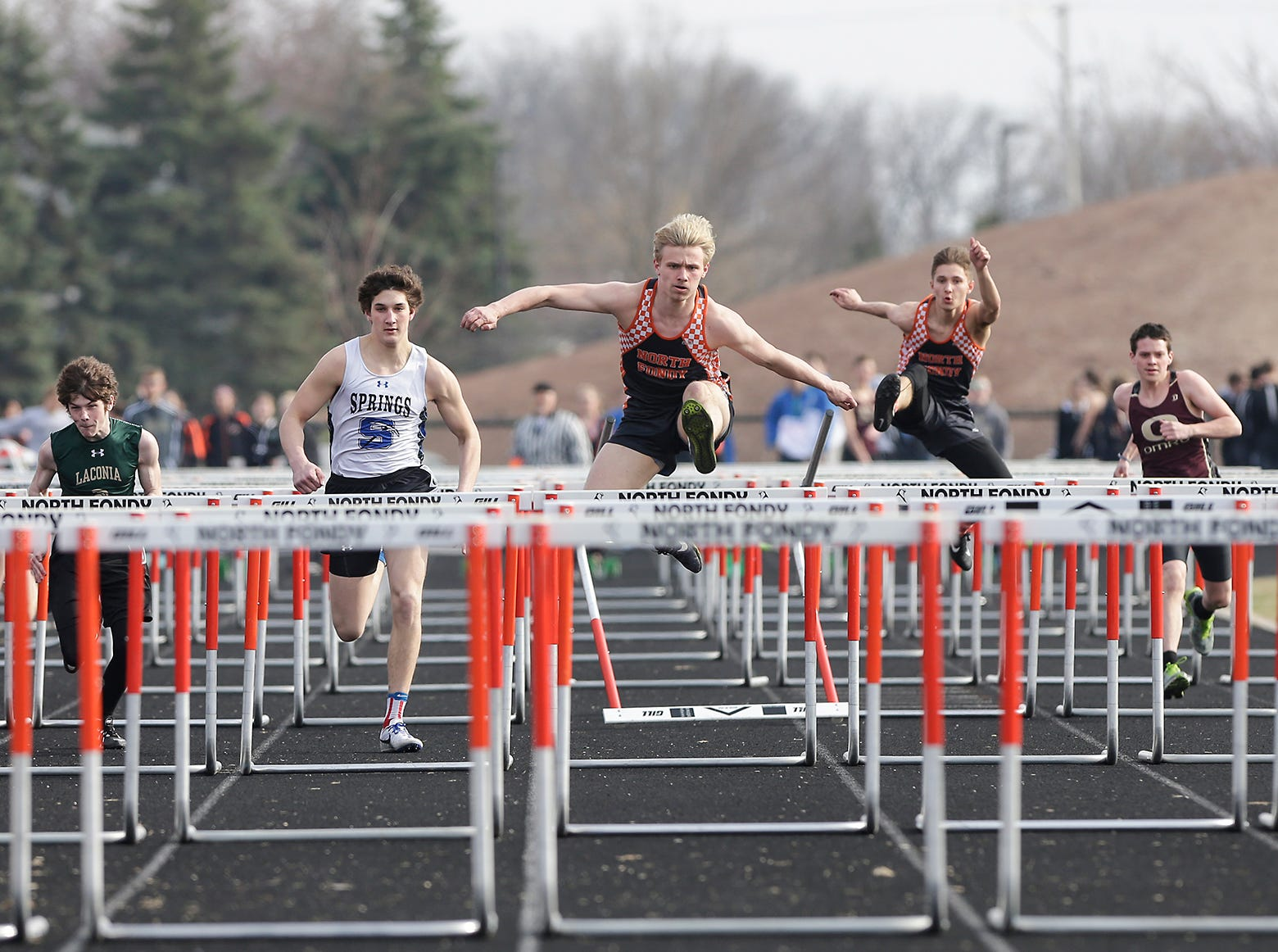 Laconia High School's Trebeck Lemond, St. Mary's Springs Academy's Jacob Koffman, North Fond du Lac's Dalton Fritch and Cameron Hilt and Omro's Gavin Knurowski and Ben Lehman take part in the boys 110 meter hurdles Tuesday, April 16, 2019 at North Fond du Lac High School in North Fond du Lac, Wis. Doug Raflik/USA TODAY NETWORK-Wisconsin