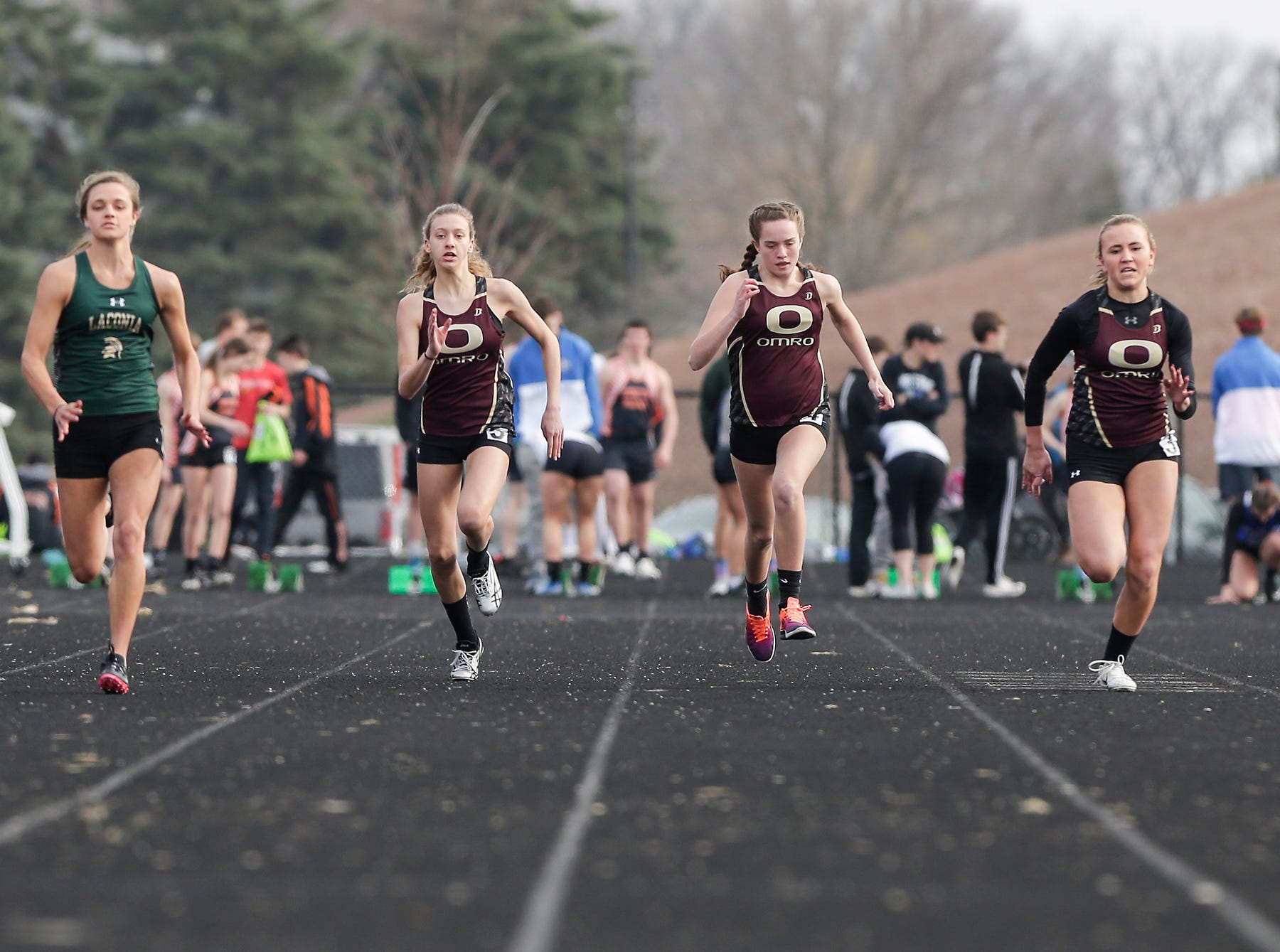 Laconia High School's Taylor VandeBerg and Omro's Audrey Stotflet, Jenna Huth and Maddie Larsen takes part in the girls 100 meter dash Tuesday, April 16, 2019 at North Fond du Lac High School in North Fond du Lac, Wis. Doug Raflik/USA TODAY NETWORK-Wisconsin