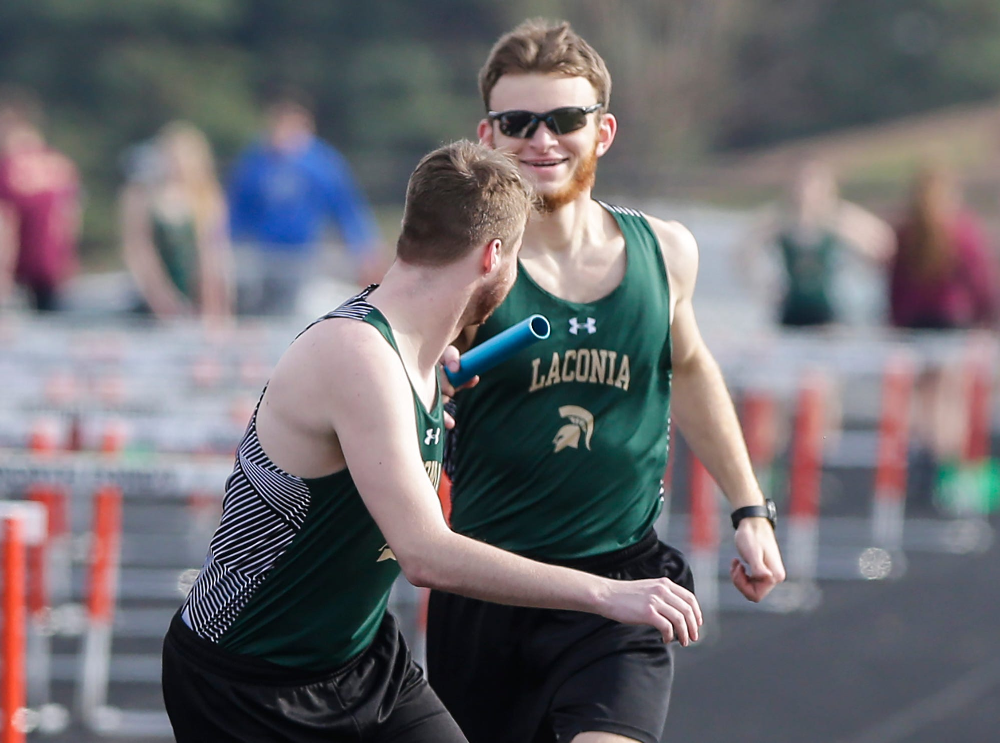 Laconia High School's Ben Pokorny hands the baton off to Jeb Loomans during the 4x800 meter relay Tuesday, April 16, 2019 at North Fond du Lac High School in North Fond du Lac, Wis. Doug Raflik/USA TODAY NETWORK-Wisconsin