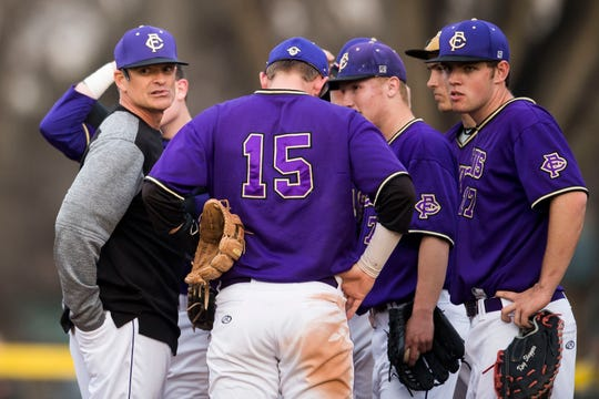 The infielders on Fort Collins High School's baseball team gathers on the mound with coach Marc Wagner during an April 16, 2019, game against Rocky Mountain at City Park. The Lambkins will play another cross-town rival at 4 p.m. Tuesday, when they host Poudre.