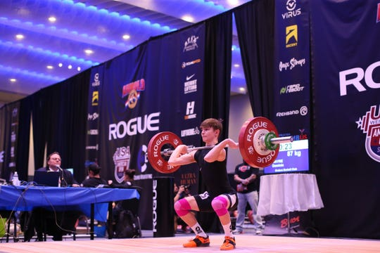 Dominic O'Hayre-Fabrizio competes in the clean and jerk at The Arnold and American Open Series 1 competition last month in Columbus, Ohio. O'Hayre-Fabrizio, a junior at Fossil Ridge High School, won the title in his weight class at the event.