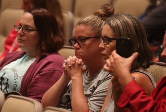 From left, Benches for Our Babes founding members Nicole Fitzpatrick, Erin Diaz and Traci DeBusman attend a school bus safety forum at the Lee County Public Education Center on Tuesday April, 16, 2019.