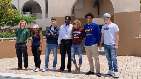 Seven Mariner athletes signed National Letters of Intent to participate in athletes at the college level in a ceremony Wednesday at the school.