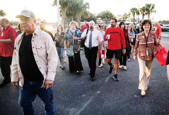"South Fort Myers High School teachers and administrators and community members staged a ""walk-in"" before classes on Wednesday, April 17, 2019. Educators across Florida joined  the walk-in to support increased funding for public schools."