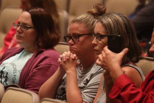 From left, Nicole Fitzpatrick, Erin Diaz and Traci DeBusman attend a school bus safety forum at the Lee County Public Education Center on Tuesday April, 16, 2019.