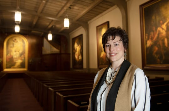 Erin Jones, director of the Museum and Gallery at Bob Jones University, stands for a portrait in the War Memorial Chapel at Bob Jones University Wednesday, April 17, 2019.
