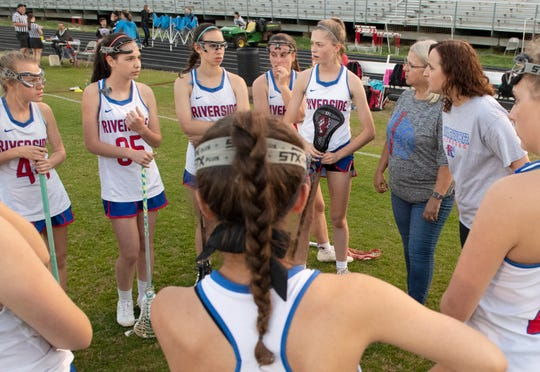 Riverside assistant coach Erin Riley and former coach DeAnn Louis talk to the team during half-time of the game against Spartanburg at Riverside High School Tuesday, April 9, 2019.