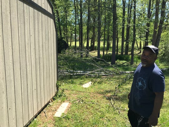 Dan Squirewell talks about damage caused by a tornado that came through Simpsonville on Sunday night while walking his property two days later on Tuesday, April 16, 2019.