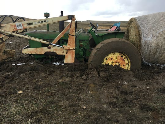 Springtime brings all kinds of fun and interesting work. Lisa Schmidt learned about the suction properties of saturated saline clay soil when she buried her tractor in a mud hole. Even the hydraulic loader was no match for the sticky mud. Lisa's shovel came to the rescue.