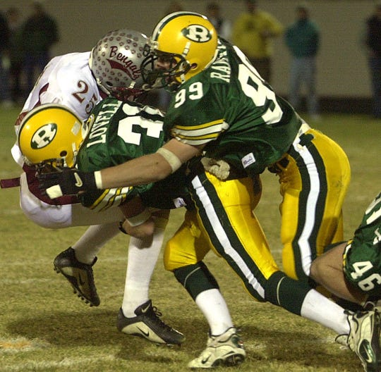 CMR defender Chris Ramstead (99) was a hard-hitting defensive end who helped lead the Rustlers to a state championship in 2001. He went on to play on a few national championship teams at Carroll College.