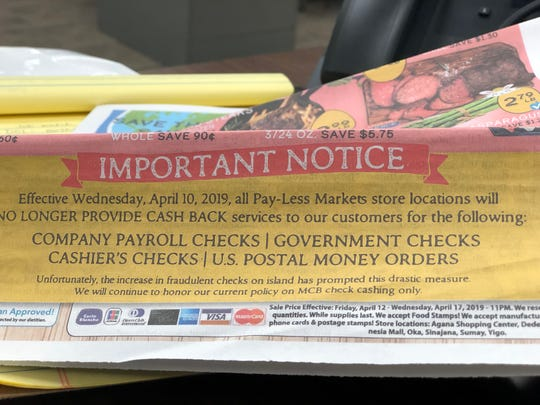 A Pay-Less Supermarkets advertisement notifying customers that they won't be cashing checks anymore at any of their locations.