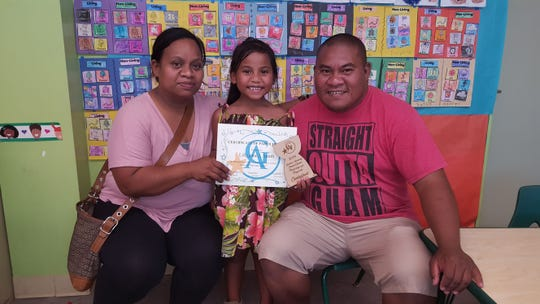 Lilly-gene Smith participated in Maga'haga and Maga'lahi competition sponsored by PTO for Mes Chamorrou on March 29. From left: Rudy James; Lilly-gene and Shalom Smith.