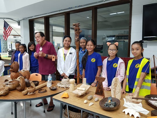 Students of M.U. Lujan Elementary School continue to promote and perpetuate the CHamoru culture by participating in the Chamoru cultural carving presentation during the Sakkan (Mes) CHamoru on March 18. Pictured from left: Ja'anah Lizama; LeShael Taimanglo; Siñot Greg Pangelinan; Aveyani Babauta; Anglyena Thineyog; Joneva Quintanilla; Denise Aguon and Hanaya Gamboa.