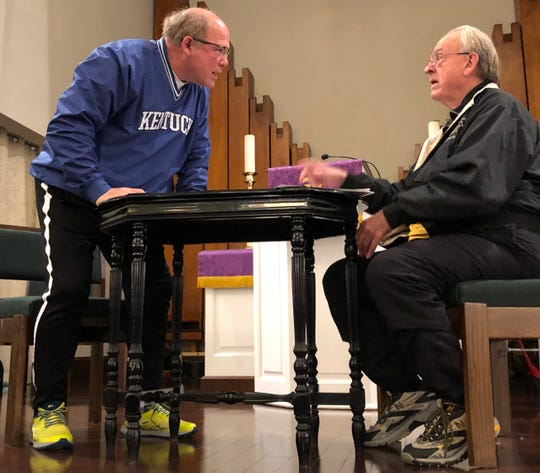 """Tempers flare as teacher Malcolm Medcalf (left, portrayed by Ray Nix) quarrels with his school superintendent (Herb McKee) over the future of tiny Taylor School during a rehearsal of Bob Park's latest musical play, """"Another Day in Heaven."""" The play will be presented April 27 at the Preston Arts Center."""